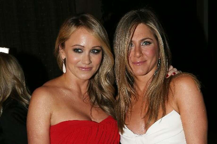 Actresses Christine Taylor (L) and Jennifer Aniston attend the 26th American Cinematheque Award Gala honoring Ben Stiller at The Beverly Hilton Hotel on November 15, 2012 in Beverly Hills, California. (Photo by Frederick M. Brown/Getty Images) (Getty)