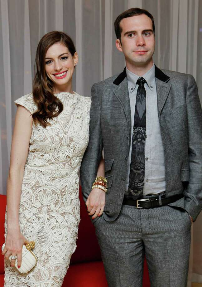 Hathaway (and her fans) can take comfort in knowing that all that hair will grow back eventually. In this August 2011 photo, Hathaway and Adam Shulman attend a party in London.  Photo: Joel Ryan, ASSOCIATED PRESS / AP2011