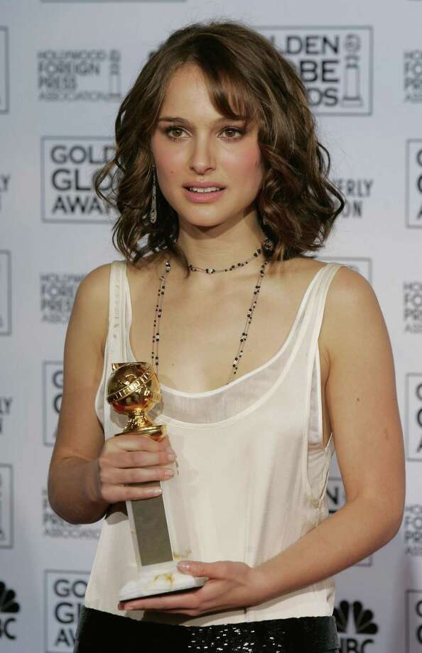 "Natalie Portman poses pre-shave with her ""best supporting actress"" Golden Globe in January 2005.   Photo: MIKE BLAKE, REUTERS / X00030"