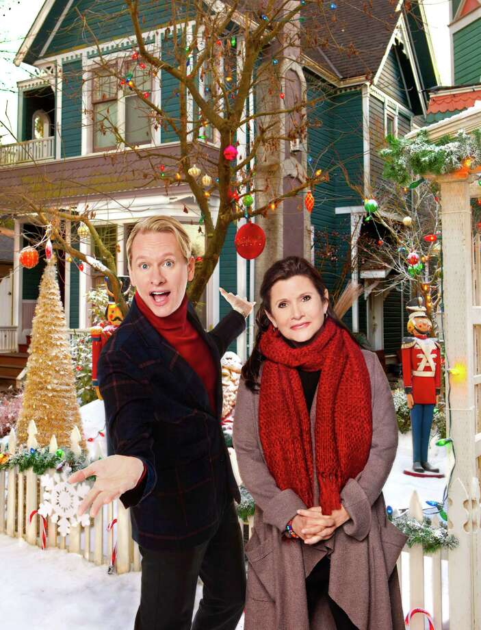 Carrie Fisher and Carson Kressley star in Hallmark's fun redo of 'A Christmas Carol' featuring a publishing house boss with a heart of snow (Emmanuelle Vaugier) as Scrooge. Photo: Marc Lemoine Photography, Hallmark Channel / © 2011 Crown Media United States, LLC
