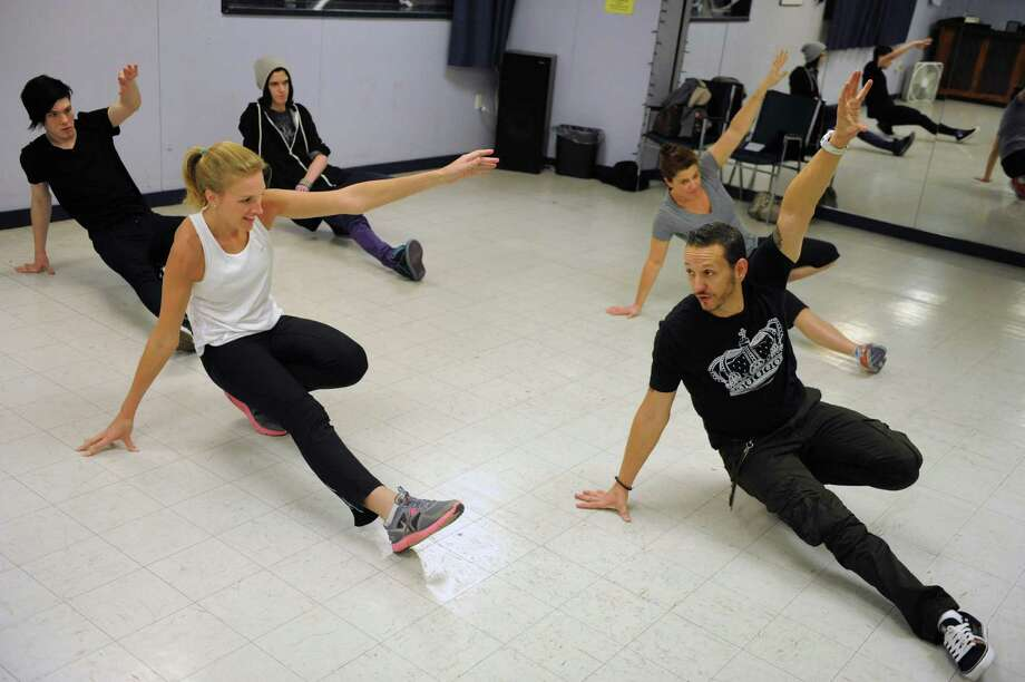 Instructor Beau Conley, right, leads a break dancing class at Lorraine Michaels Studio in Albany, NY Wednesday Nov. 14, 2012. (Michael P. Farrell/Times Union) Photo: Michael P. Farrell