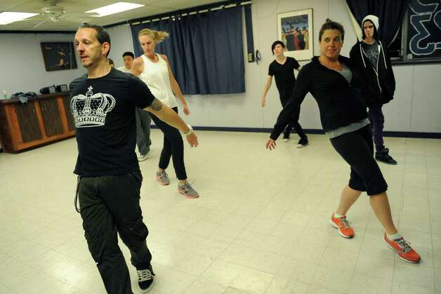 Instructor Beau Conley, left, leads a break dancing class at Lorraine Michaels Studio in Albany, NY Wednesday Nov. 14, 2012. (Michael P. Farrell/Times Union) Photo: Michael P. Farrell