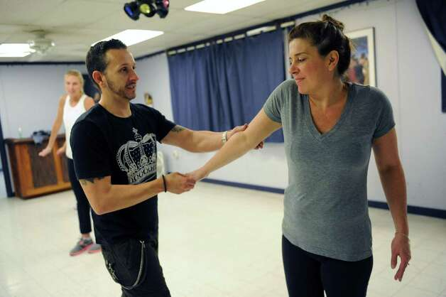 Instructor Beau Conley, left,works with Tracy Ormsbee during a break dancing class at Lorraine Michaels Studio in Albany, NY Wednesday Nov. 14, 2012. (Michael P. Farrell/Times Union) Photo: Michael P. Farrell