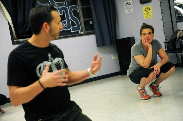 Instructor Beau Conley, left, talks with Tracy Ormsbee during a break dancing class at Lorraine Michaels Studio in Albany, NY Wednesday Nov. 14, 2012. (Michael P. Farrell/Times Union) Photo: Michael P. Farrell