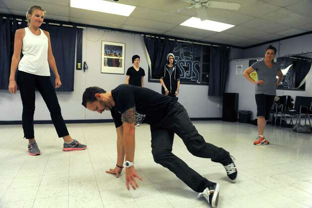 Instructor Beau Conley leads a break dancing class at Lorraine Michaels Studio in Albany, NY Wednesday Nov. 14, 2012. (Michael P. Farrell/Times Union) Photo: Michael P. Farrell