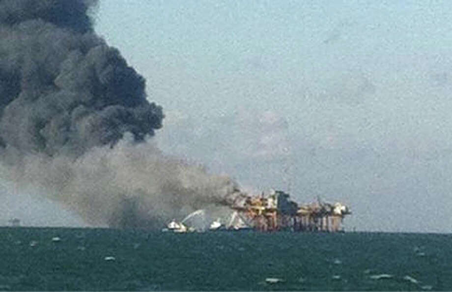 In this image released by a oil field worker and obtained by the Associated Press, a fire burns on a Gulf oil platform Friday, Nov. 16, 2012, after an explosion on the rig, in the Gulf of Mexico off the Louisiana coast. An explosion and fire ripped through a Gulf oil platform Friday as workers used a cutting torch, sending at least four people to a hospital with burns and leaving two missing in waters off Louisiana. Photo: Associated Press / AP