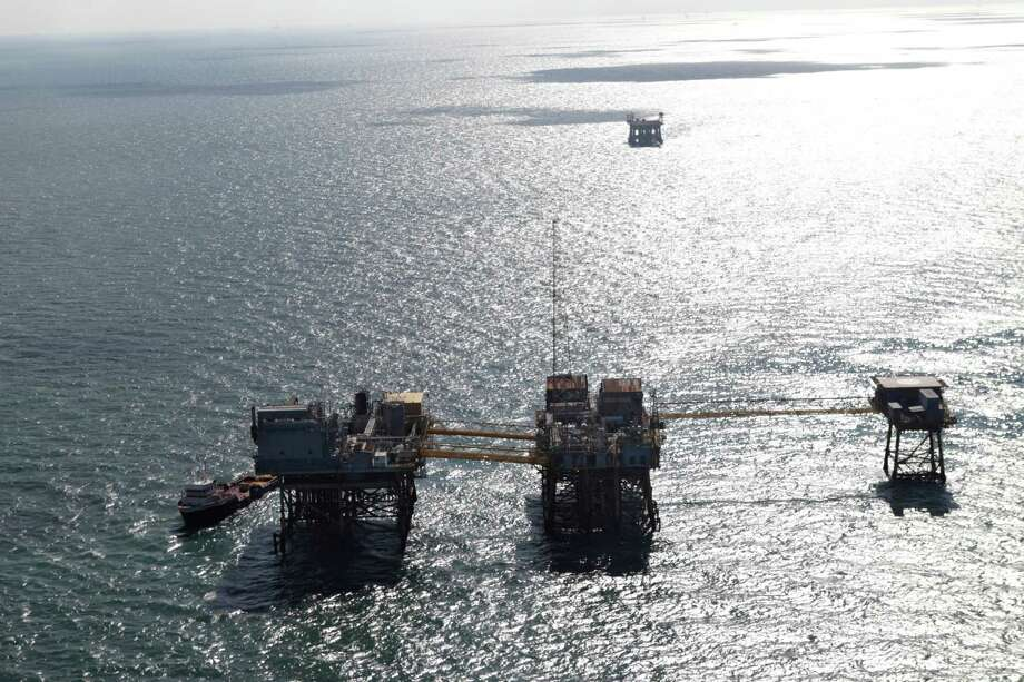 This aerial photograph shows an oil rig damaged from an explosion and fire in the Gulf of Mexico, about 25 miles southeast of Grand Isle, La., Friday, Nov. 16, 2012. Four people were transported to a hospital with critical burns and two were missing. Photo: Gerald Herbert, Associated Press / AP