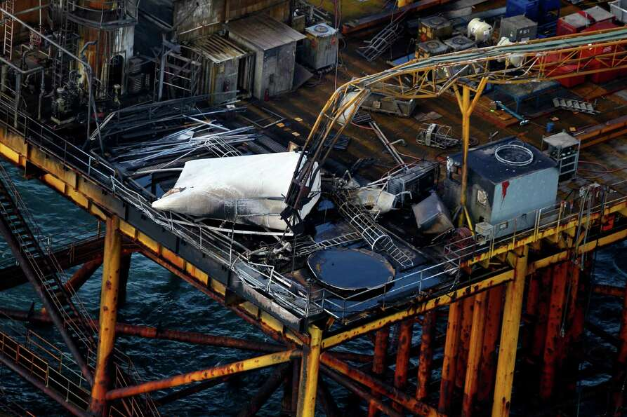 This aerial photograph shows damage from an explosion and fire on an oil rig in the Gulf of Mexico,
