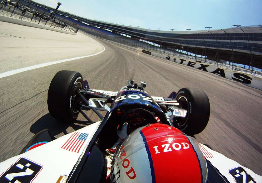 Mario Andretti drives Travis Pastrana in a two-seater IndyCar at Texas Motor Speedway on June 8, 2012 in Fort Worth, Texas. (Getty Images for Texas Motor Speedway)