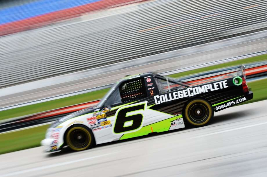 Justin Lofton drives the #6 CollegeComplete.com Chevrolet during a track evaluation prior to practice for the NASCAR Camping World Series WinStar World Casino 400 at Texas Motor Speedway on June 7, 2012 in Fort Worth, Texas. (Getty Images for Texas Motor Speedway)