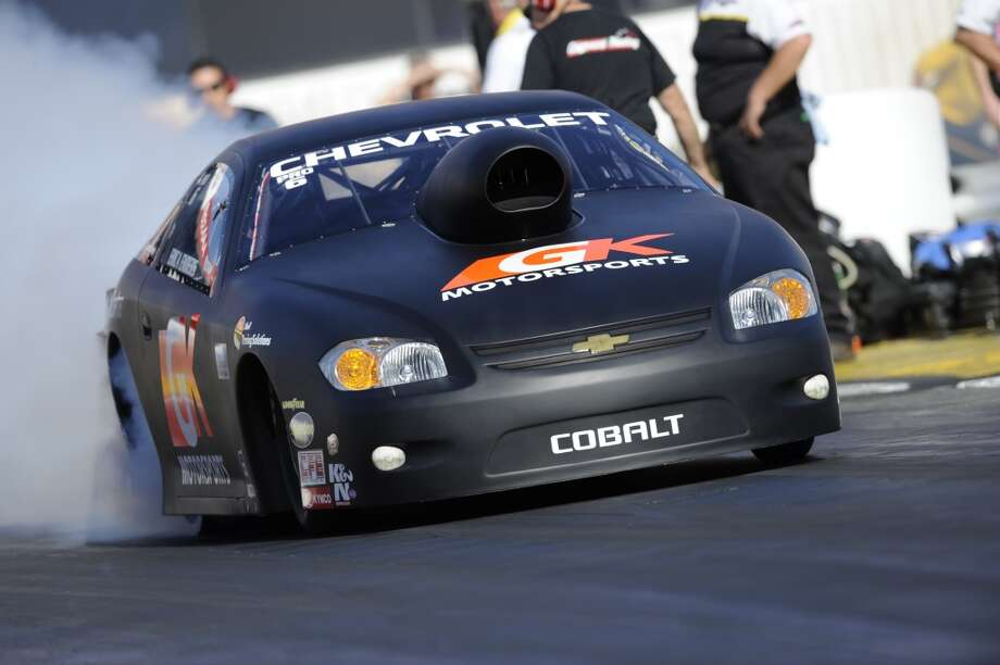Erica Enders of Houston does a burnout in her GK Motorsports Chevrolet Cobalt NHRA Pro Stock car at the Texas Motorplex in Ennis, Texas.  (NHRA photo)