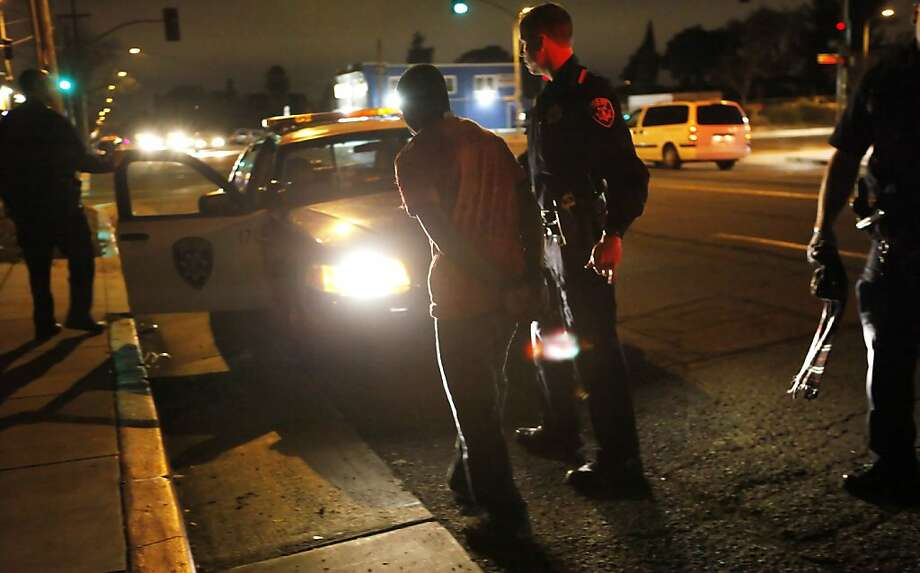 An East Oakland arrest seems almost routine in the city, where crime has become residents' primary fear. Photo: Lacy Atkins, The Chronicle