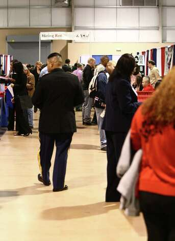 Job seekers at a job fair that the Tx Workforce Commission and Tx Veterans Commission is hosting at Expo Hall on the Freeman Coliseum grounds, 3201 E. Houston St. Thursday November 15, 2012 Photo: Juanito M Garza, San Antonio Express-News / San Antonio Express-News