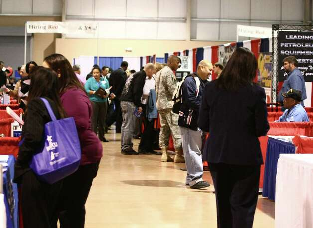 People attend a local jobs fair in November. In December, employment numbers rose, the workforce commission said. Photo: Juanito M Garza, San Antonio Express-News / San Antonio Express-News