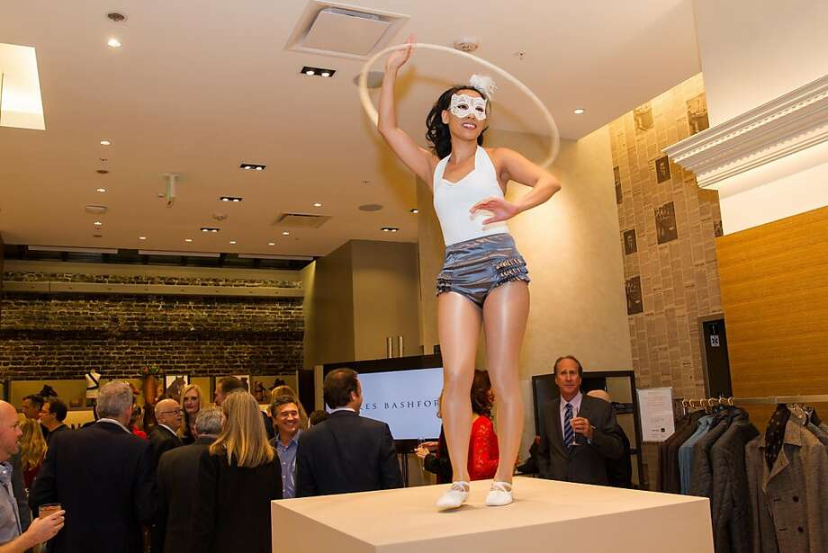 Festivities at the Wilkes Bashford store reopening included entertainment on pedestals. Photo: Drew Altizer Photography