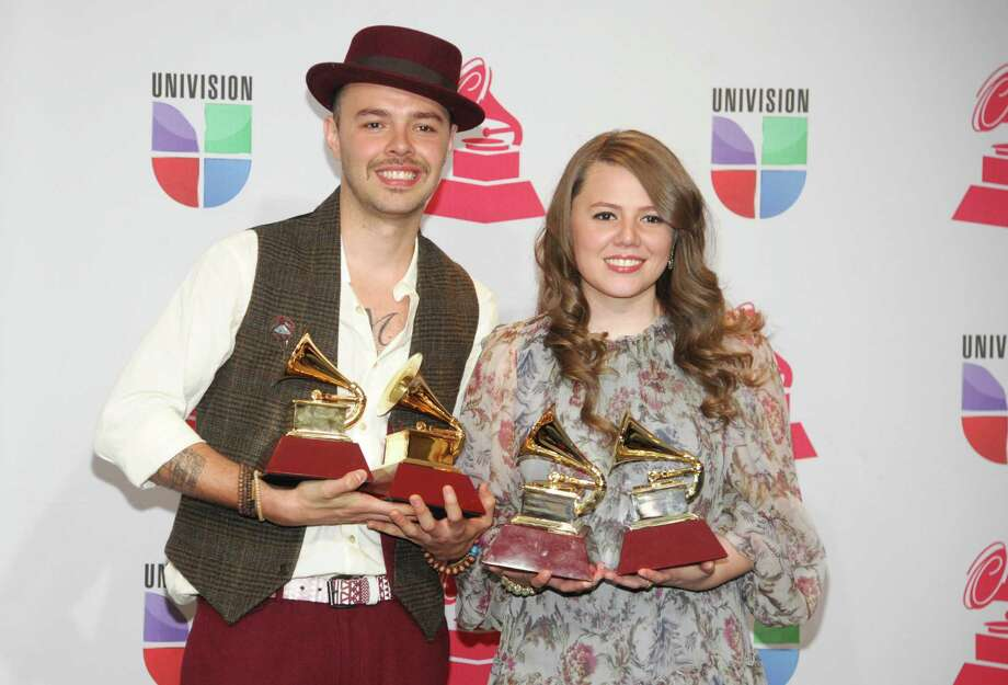 "Jesse & Joy pose backstage with the best contemporary pop vocal album award for ""Con Quien Se Queda el Perro"" and song of the year for ""Corre!"" at the 13th Annual Latin Grammy Awards at Mandalay Bay on Thursday, Nov. 15, 2012, in Las Vegas. (Photo by Brenton Ho/Powers Imagery/Invision/AP) Photo: Brenton Ho"