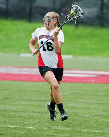 New Canaan's Wheatley Raabe in action during her team's 9-6 win over Darien at New Canaan High School in the Class M quarterfinals at New Canaan High School. Raabe signed her Letter of Intent to play lacrosse at the University of California Berkeley. Photo: Keelin Daly / Stamford Advocate