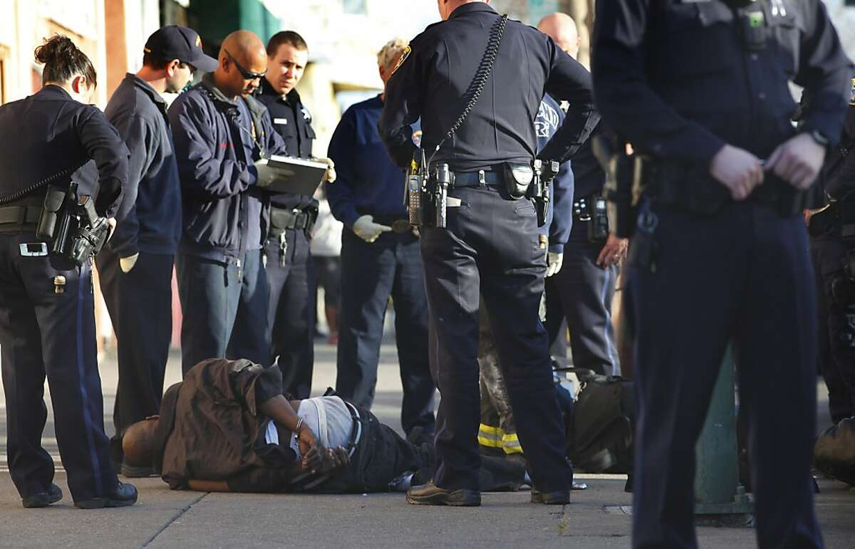 Police make an arrest after the suspect attacked an officer on International Boulevard, Monday February 20, 2012, in Oakland, Calif. Three weeks before a federal judge will hear arguments to decide whether Oakland should hand over its Police Department to federal authorities, attorneys for one of the parties filed a searing critique against the embattled law enforcement agency.