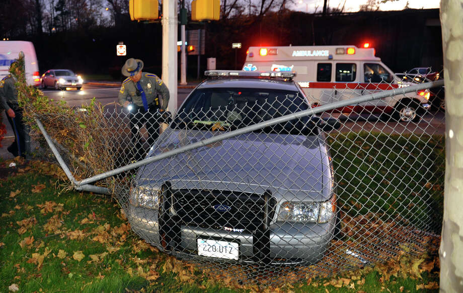 State police investigate an accident involving one of their own cruisers at the intersection of Prospect and Warren Streets in Bridgeport, Conn. on Friday November 16, 2012. Photo: Christian Abraham / Connecticut Post
