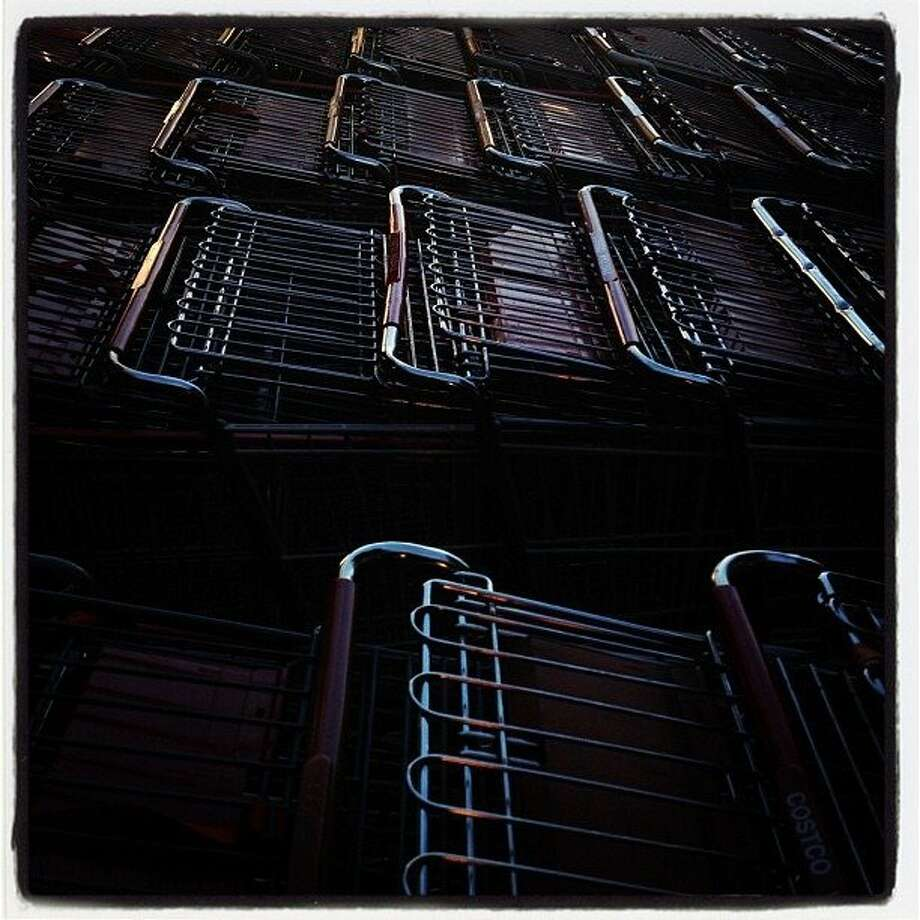 How many millions of pounds of food, toilet paper, industrial sized cleansers, or other items have these Costco carts seen? They're not telling.  http://instagr.am/p/R_Kt4IEyWA/ Photo: Carlos Gonzalez, The Chronicle