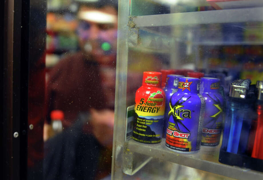 Various popular energy drinks are for sale on a shelf at K&H food store on Fairfield Avenue in Bridgeport, Conn. on Friday November 16, 2012. The FDA has announced that it will investigate the popular drink which has led to 13 deaths and 33 hospitalizations over the past four years. Photo: Christian Abraham / Connecticut Post
