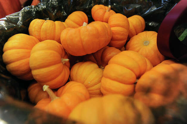 Pumpkins in a basket at Market Basket in Beaumont. Photo taken Tuesday, November 13, 2012 Guiseppe Barranco/The Enterprise Photo: Guiseppe Barranco, STAFF PHOTOGRAPHER / The Beaumont Enterprise