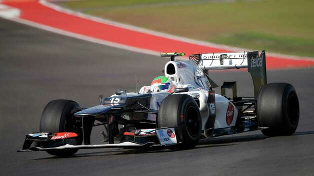 Sauber driver Sergio Perez of Mexico, steers his car during the second free practice session for Formula One's U.S. Grand Prix auto race at the Circuit of The Americas, Friday, Nov. 16, 2012, in Austin, Texas. The race is scheduled for Sunday. (AP Photo/David J. Phillip) Photo: David J. Phillip, Associated Press / AP