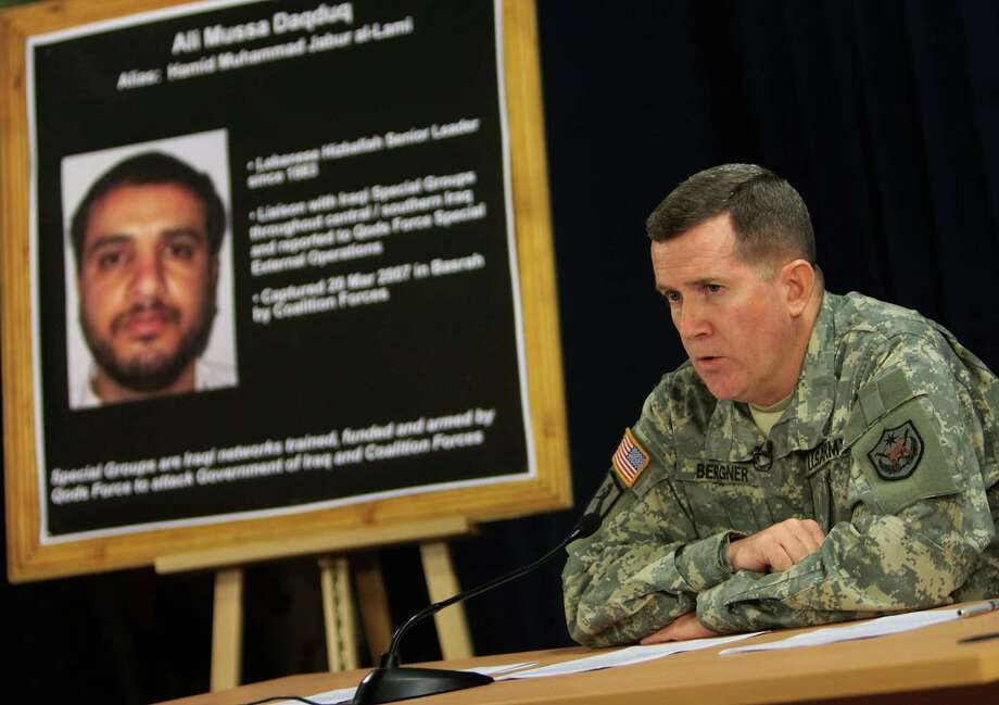 In this July 2, 2007, file photo U.S. military spokesman Brig. Gen. Kevin J. Bergner speaks during a press conference in Baghdad, Iraq, near a poster of a senior Lebanese Hezbollah operative Ali Mussa Daqduq. A Hezbollah commander wanted by the United States has been released from Iraqi custody and returned to the Lebanese capital on Friday, Nov. 16, 2012, his lawyer said. The move is likely to complicate the Obama administration's efforts to prosecute the militant believed to have been the mastermind of an attack that killed five U.S. soldiers. The release of Lebanese-born Ali Mussa Daqduq also underscored how little influence Washington holds over Baghdad's government since American troops left the country last December.(AP Photo/Wathiq Khuzaie, Pool, File) Photo: WATHIQ KHUZAIE, Associated Press / POOL GETTY