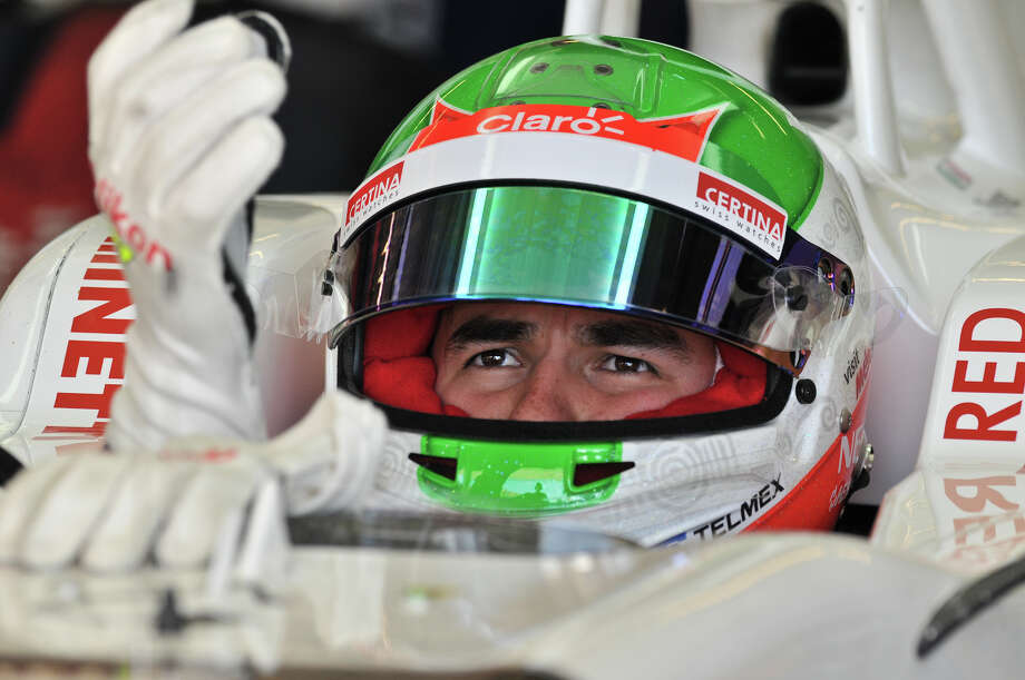 Mexican driver Sergio Perez puts on his gloves prior to starting the second practice session Friday for the United States Grand Prix at the Circuit of the America's in Austin. Photo: For The Express-News