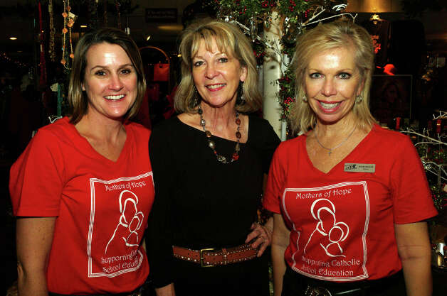 Founding Mother Lynnanne Eurton (from left), Salado Creek Boutique  co-owner Anne Wright and Hope for the Future director Julie Seguin  gather during the Mothers of Hope's Mamas & Mistletoe event at  Salado Creek Boutique at Los Patios. Photo: Leland A. Outz, For The Express-News / SAN ANTONIO EXPRESS-NEWS