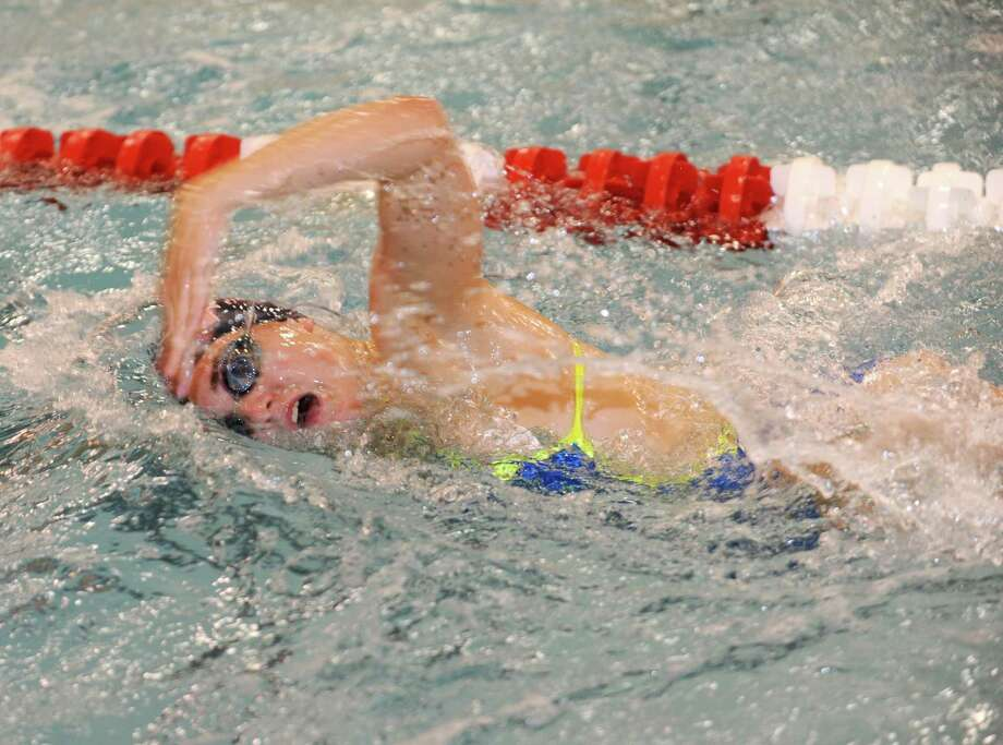 Co-captain Maddie Dunn and the rest of the Greenwich swim team will battle rival Darien for the CIAC Open title Saturday at Yale. Photo: Helen Neafsey / Greenwich Time