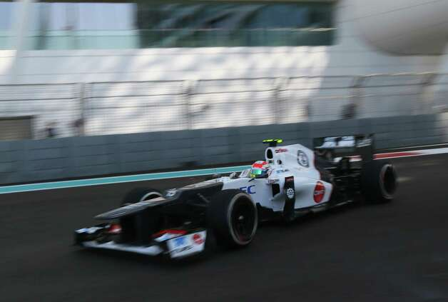 Sauber's Mexican driver Sergio Perez  drives during the first practice session at the Yas Marina circuit on November 2, 2012 in Abu Dhabi ahead of the Abu Dhabi Formula One Grand Prix.   AFP PHOTO / MARWAN NAAMANIMARWAN NAAMANI/AFP/Getty Images Photo: MARWAN NAAMANI, Getty Images / AFP