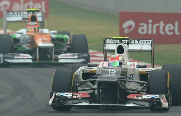 Sauber-Ferrari driver Sergio Perez of Mexico (R) takes a corner as Force India-Mercedes driver Nico Hulkenberg of Germany pursues during the Formula One Indian Grand Prix in Greater Noida, on the outskirts of New Delhi on October 28, 2012.  AFP PHOTO/ MANAN VATSYAYANAMANAN VATSYAYANA/AFP/Getty Images Photo: MANAN VATSYAYANA, Getty Images / AFP