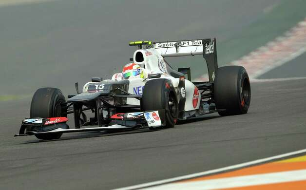 Sauber-Ferrari driver Sergio Perez of Mexico  powers his car during the third practice session at the Buddh International circuit in Greater Noida, on the outskirts of New Delhi on October 27, 2012. The Formula One Indian Grand Prix 2012 will take place on October 28.   AFP PHOTO/ PRAKASH SINGHPRAKASH SINGH/AFP/Getty Images Photo: PRAKASH SINGH, Getty Images / AFP