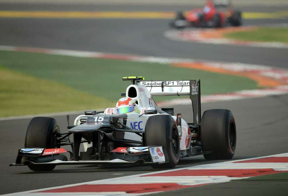 Sauber-Ferrari driver  Sergio Perez of Mexico powers his car during the second practice session at the Buddh International circuit in Greater Noida, on the outskirts of New Delhi on October 26, 2012. The Formula One Indian Grand Prix 2012 will take place on October 28.   AFP PHOTO/ MANAN VATSYAYANAMANAN VATSYAYANA/AFP/Getty Images Photo: MANAN VATSYAYANA, Getty Images / AFP