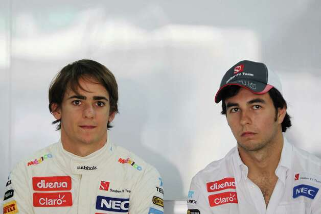 Esteban Gutierrez (L) of Mexico and Sauber F1 talks with fellow countryman Sergio Perez (R) as he prepares to drive during practice for the Indian Formula One Grand Prix at Buddh International Circuit on October 26, 2012 in Noida, India. Photo: Ker Robertson, Getty Images / 2012 Getty Images