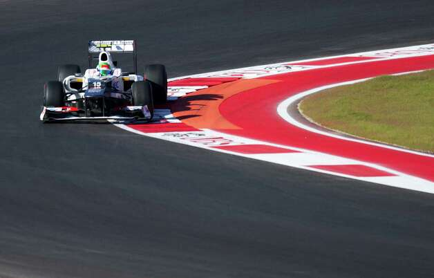 Mexico's Sergio Perez of Team Sauber F1 exits turn 9 during the first practice session for the United States Formula One Grand Prix at the Circuit of the Americas on November 16, 2012 in Austin, Texas.                AFP PHOTO/Jim WATSONJIM WATSON/AFP/Getty Images Photo: JIM WATSON, Getty Images / AFP
