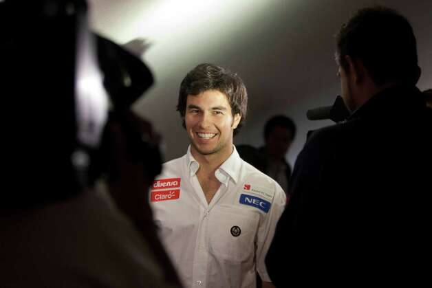 Sauber F1 driver Sergio Perez of Mexico arrives to attend a press conference in Mexico City, Wednesday, Nov. 7, 2012. (AP Photo/Alexandre Meneghini) Photo: Alexandre Meneghini, Associated Press / AP