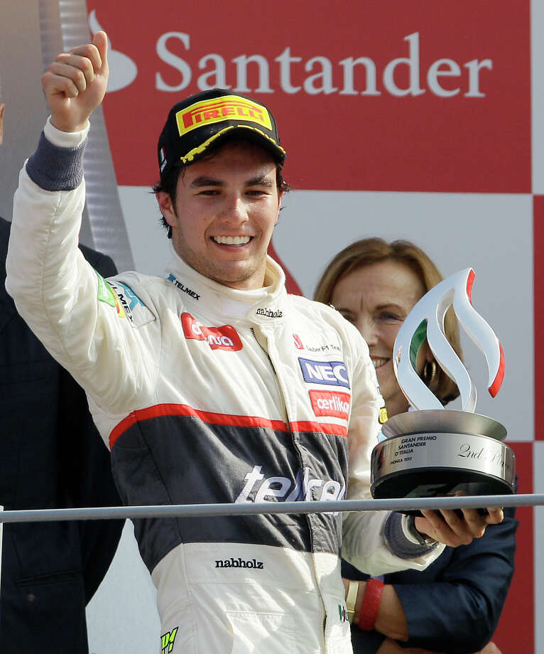 Sauber driver Sergio Perez, of Mexico, celebrates on the podium after taking second place during the Italian Formula One GP, at the Monza racetrack, in Monza, Italy, Sunday, Sept. 9, 2012.  (AP Photo/Antonio Calanni) Photo: Antonio Calanni, Associated Press / AP