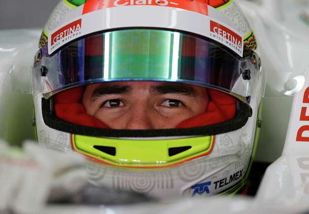 Sauber driver Sergio Perez of Mexico  sits in his car during the second practice session for the Indian Formula One Grand Prix at the Buddh International Circuit in Noida, on the outskirts of New Delhi, India, Friday, Oct. 26, 2012. (AP Photo/Mark Baker) Photo: Mark Baker, Associated Press / AP