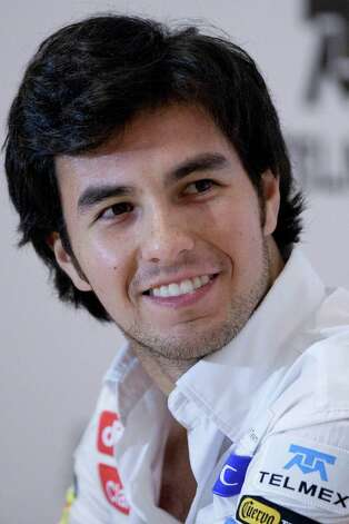 Sauber F1 driver Sergio Perez of Mexico smiles during a press conference in Mexico City, Wednesday, Nov. 7, 2012. (AP Photo/Alexandre Meneghini) Photo: Alexandre Meneghini, Associated Press / AP