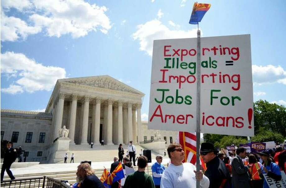 A supporter of the Arizona Immigration Law stands outside of the Supreme Court in Washington, D.C. in April 2012 (MANDEL NGAN/ Getty)