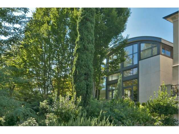 "McGilvra Modern: Gretchen Andrews Harriott designed this house, which ""is a modern blend of soft curves and industrial edginess,"" according to the listing. Photo: Courtesy Realogics Sotheby's International Realty"