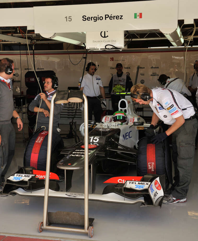 Mexican driver Sergio Perez waits in his car during the second practice session Friday for the United States Grand Prix at the Circuit of the America's in Austin. Photo: For The Express-News