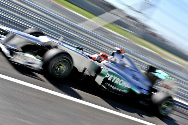 Michael Schumacher drives through the pit lane during the second practice session Friday for the United States Grand Prix at the Circuit of the America's in Austin. Photo: For The Express-News