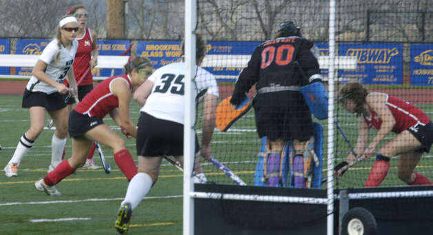 Green Wave goaltender Meeghan Doris stones a Ram player at the goal's doorstep during New Milford High School field hockey's 1-0 triple-overtime victory over New Canaan in the state  class 'L' quarterfinals at Brookfield High. Nov. 12, 2012 Photo: Norm Cummings