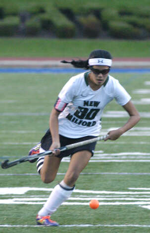 The Green Wave's quicksilver Kristi Montemurro sprints toward the goal during New Milford High School field hockey's 1-0 triple-overtime victory over New Canaan in the state  class 'L' quarterfinals at Brookfield High. Nov. 12, 2012 Photo: Norm Cummings