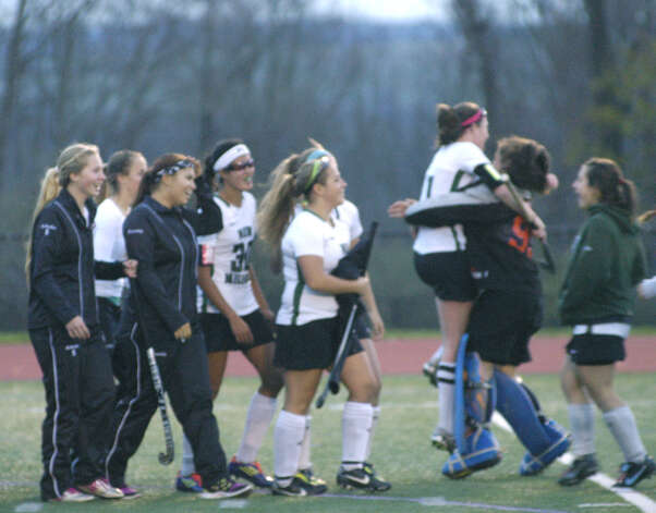 Green Wave players celebrate New Milford High School field hockey's 1-0 triple-overtime victory over New Canaan in the state  class 'L' quarterfinals at Brookfield High. Nov. 12, 2012 Photo: Norm Cummings