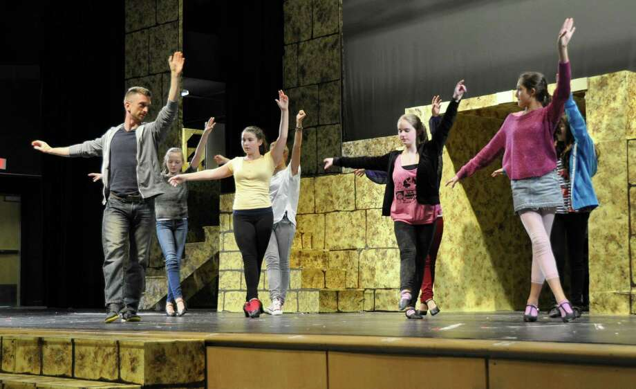 "Associate choreographer Mike Kirsch, left, works with dancers on the ""Go, Go, Go Joseph"" number during a rehearsal for Bedford Middle School's production of ""Joseph and the Technicolor Dreamcoat."" Photo: Contributed Photo / Westport News contributed"