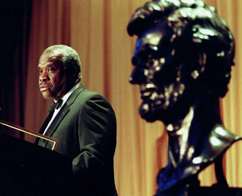 Supreme Court Justice Clarence Thomas Photo: KAMENKO PAJIC, STR / AP